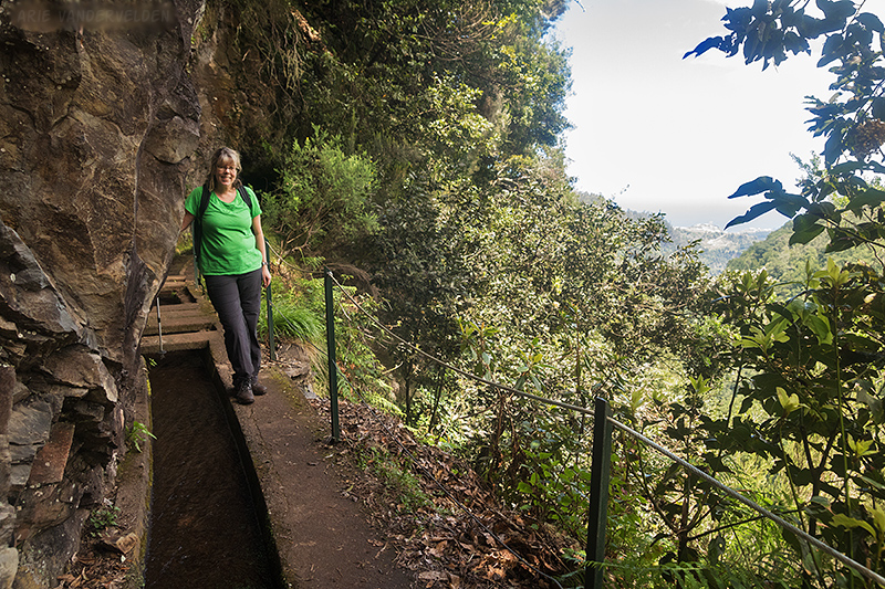 Steep section. Behind Diana is a short tunnel. The greenery hides the tremendous dropoff to the right.