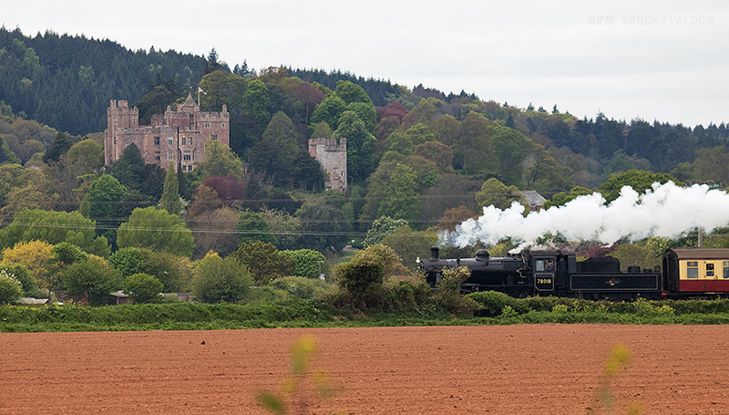 Steam train going past Dunster Castle