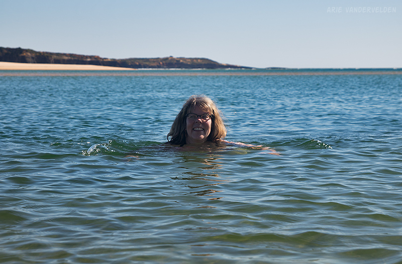 Diana swims in the sea.