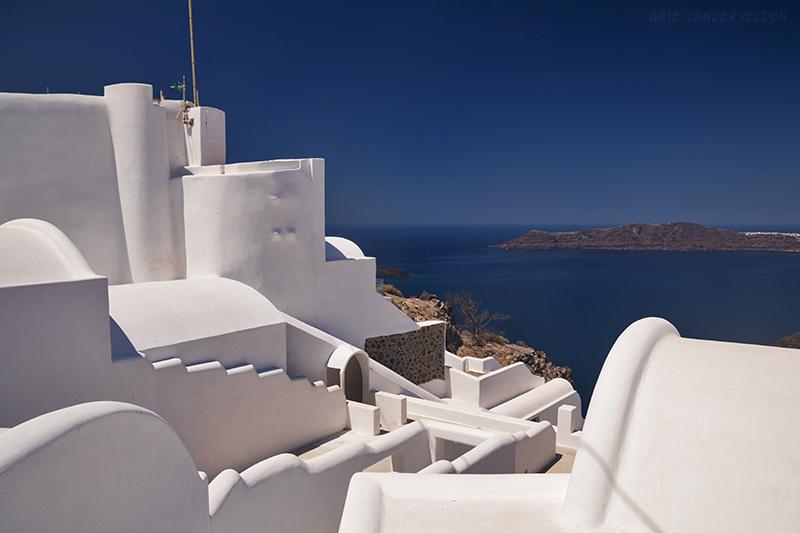 Blue sea, blue sky, whitewashed buildings.