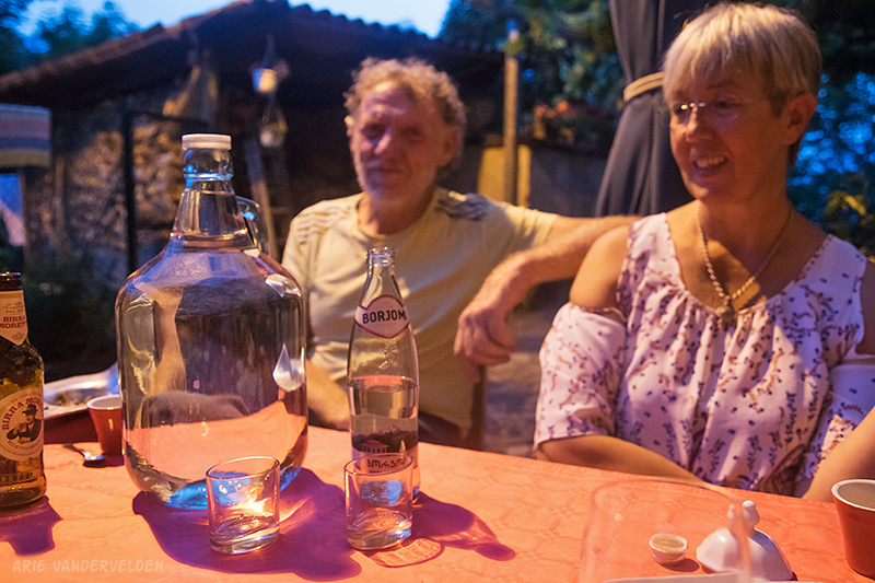Taste-testing Italian grappa (big jug) and Zaal's chacha (in the Borjomi water bottle) with our friends Mario and Maria. The chacha got the nod of approval.