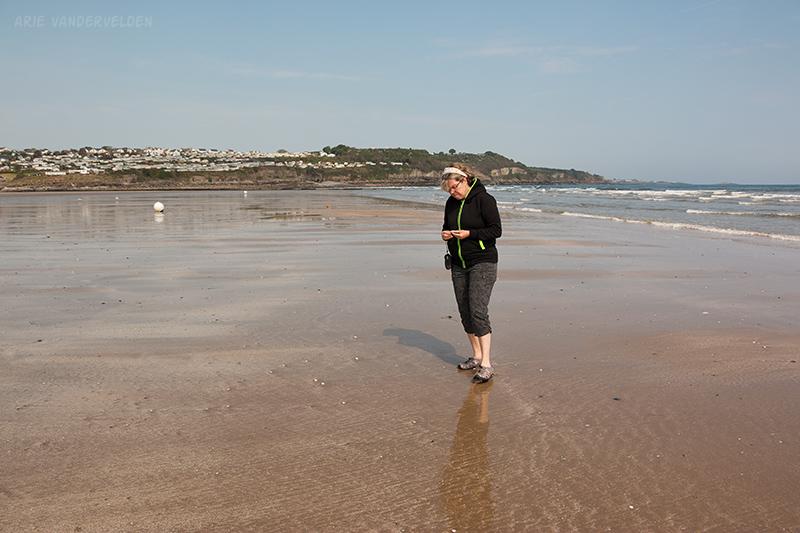 Diana examines a seashell, Benllech.