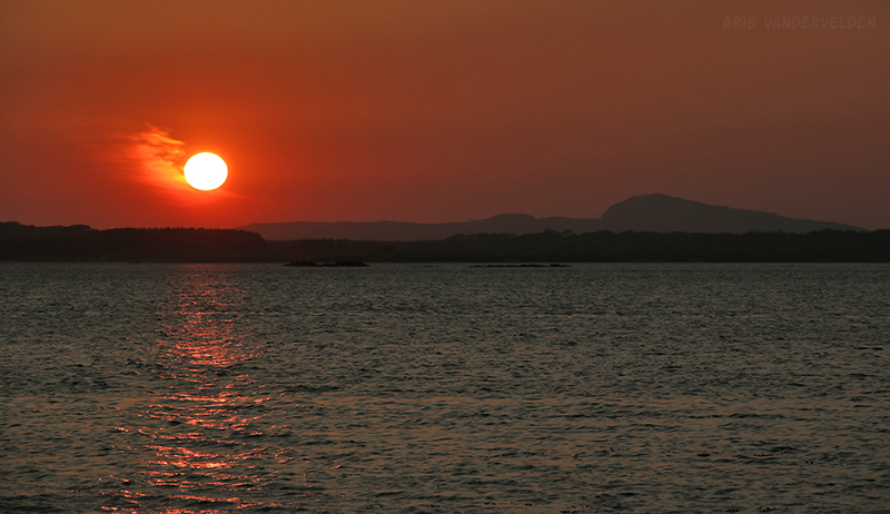 Sunset, Rhosneigr. Holy Mountain is on the right.