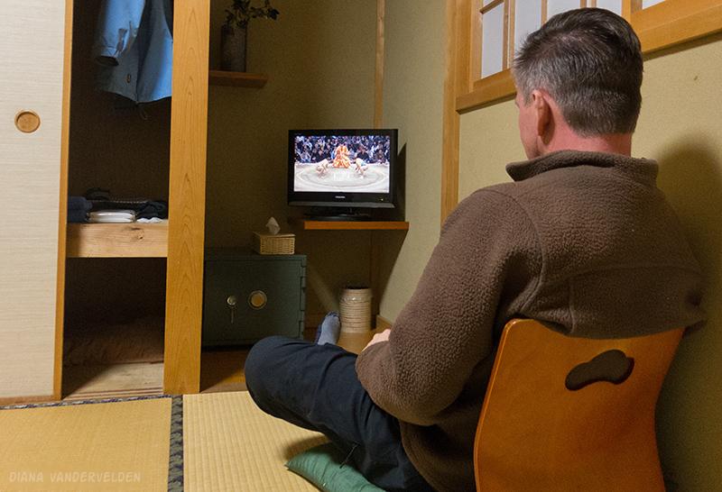 Arie watching sumo wrestling.