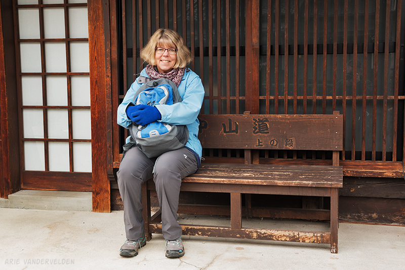 Taking a break on a wooden bench. Note that the inscription says Nakasendo: 中山道