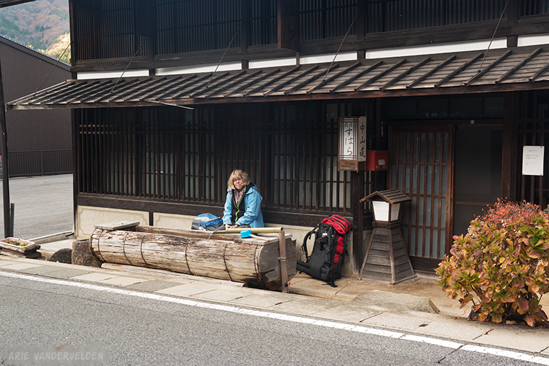 Diana in front of the minshuku. The water trough is a sign of hospitality.