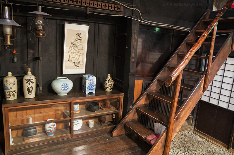 Staircase and display case inside of the minshuku.
