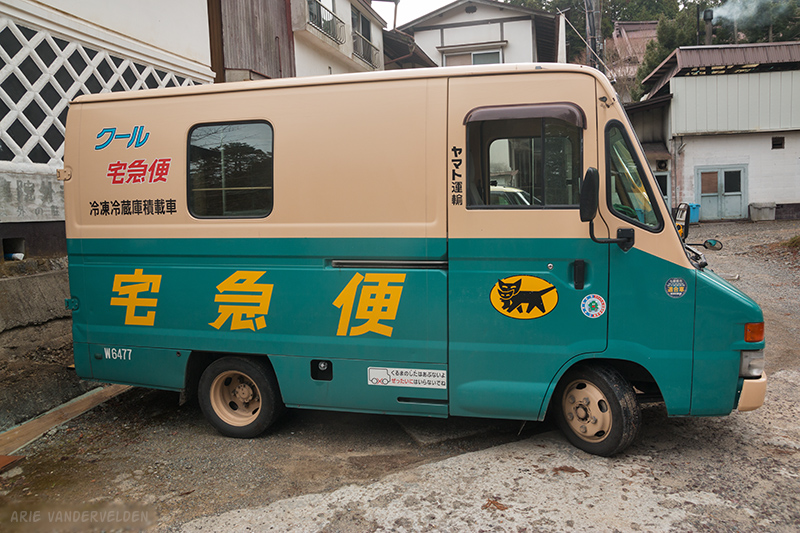 A Takkyubin delivery van. Note the cat symbol; look for it in shop windows to find a drop-off location.