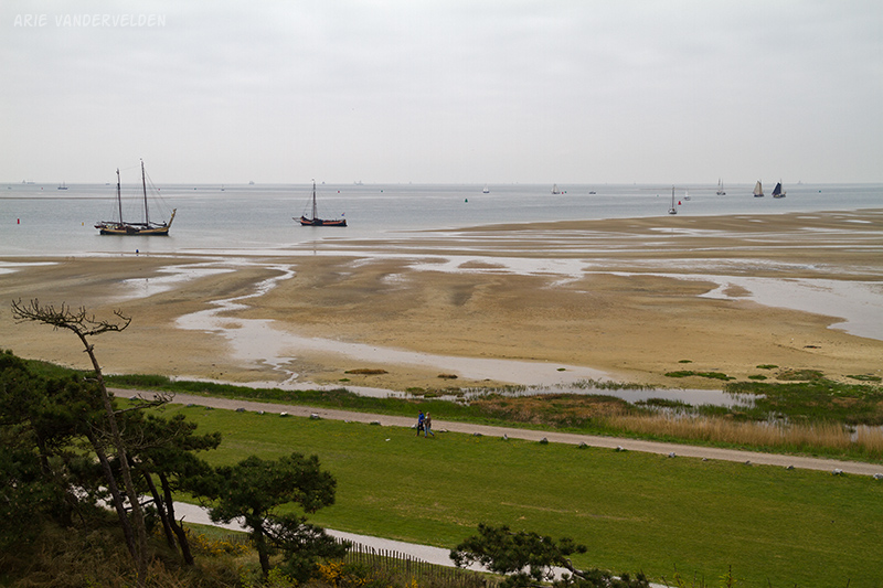 Looking out over the Waddenzee, with sandbars exposed at low tide. Sailing traditional wooden ships is a very popular activity.