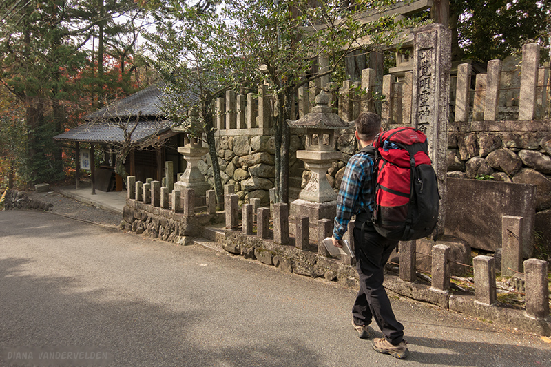 Walking past a village shrine.